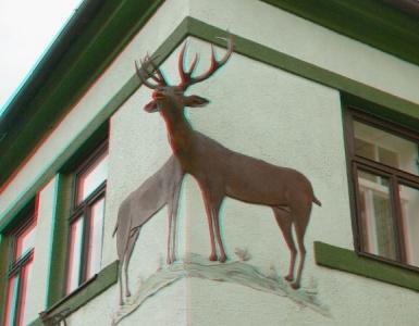 Hlava jelena a dvě jeho těla